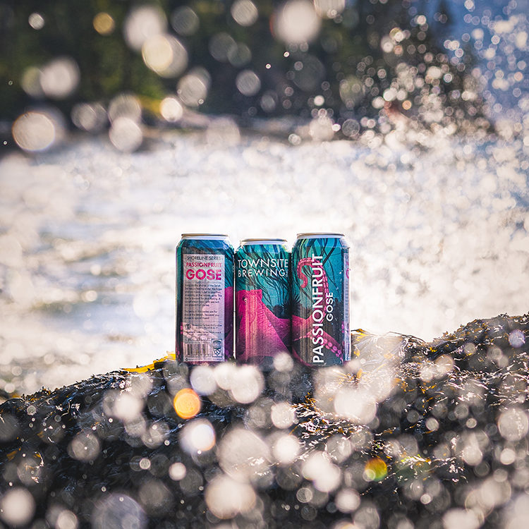 Passionfruit-Gose-Cans-In-Ocean-Surf
